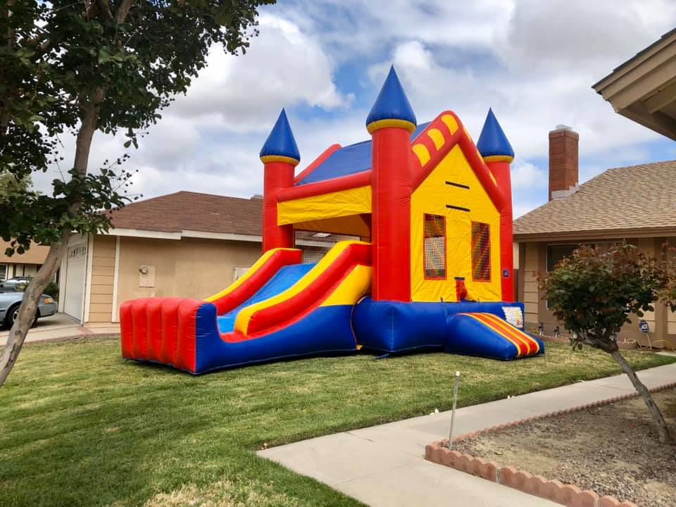 Large bounce house combo slide